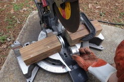 4: Wood clamped on to the saw for stability.